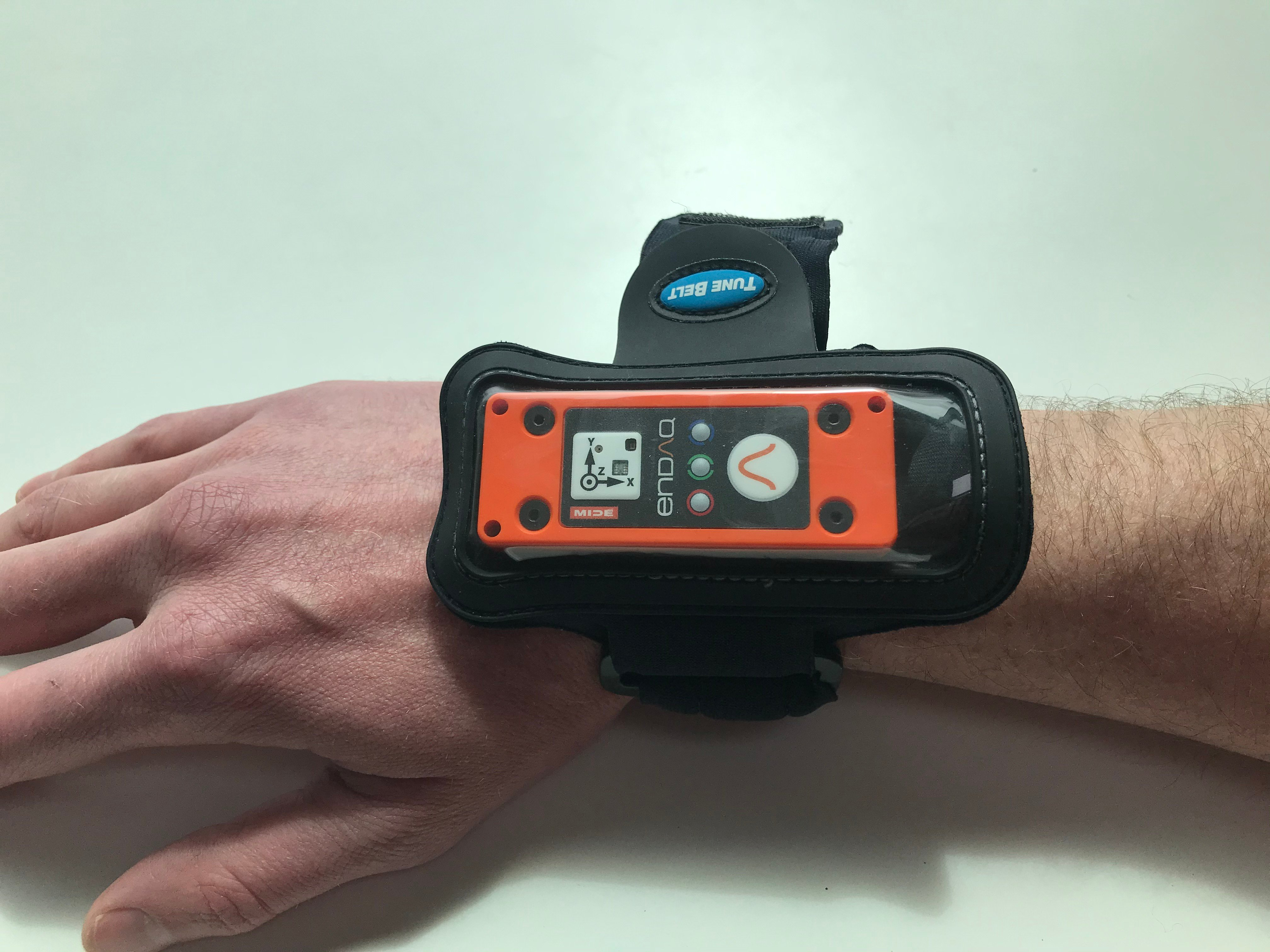 enDAQ sensor attached to wrist to gather shock and vibration data